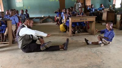 Sackey Percy dancing in his classroom