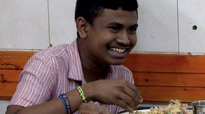 Sri Lankan boy eating kottu roti