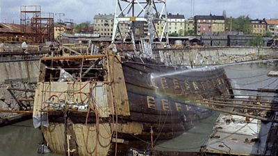 Vasa ship part out of the water in a dock