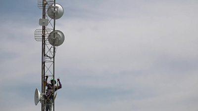man climbs up network tower