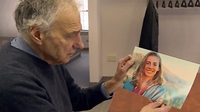 Ralph Nader holding a photo of his niece