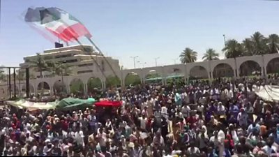 Crowds of people gather outside the army's headquarters in Khartoum