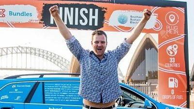Dutch adventurer Wiebe Wakker finishes his three-year electric car journey from the Netherlands to Australia, in Sydney