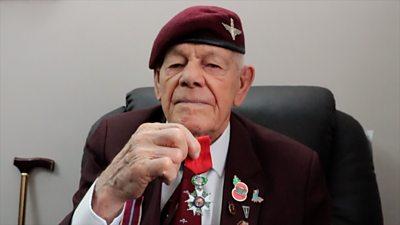 Leonard holding his Legion d'Honneur medal