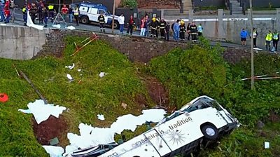 A bus carrying German tourists has plunged off a road and overturned on the Portuguese island of Madeira.