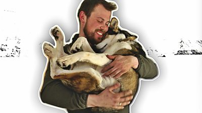 Audun cuddling husky