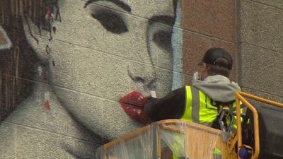 Artists have spent recent days working on their creations on walls and the sides of buildings around the city.