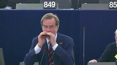 MEP Lojze Peterle plays harmonica in the European Parliament