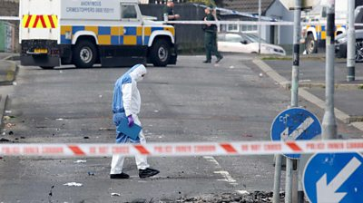 A forensic officer examines the scene of the violence in Londonderry