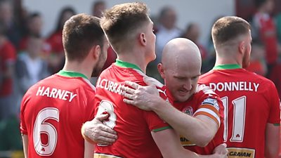 Cliftonville's Ryan Curran celebrates with Ryan Catney