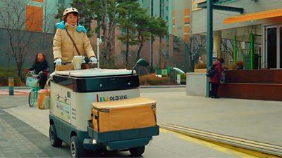 Korean lady driving a motorised fridge