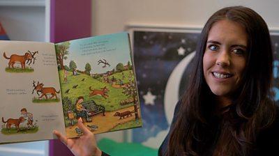 Teacher holds storybook