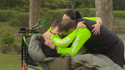 The Kerr family hugging.