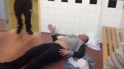 A prisoner lying on the floor
