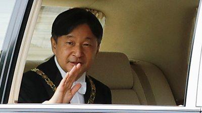 Emperor Naruhito waves from his car