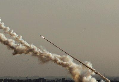 A rocket fired from Gaza flies towards Israel