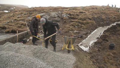 Voluntourists rebuild a walking path popular with Faroese farmers