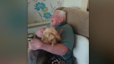 Man holding a very excited dog