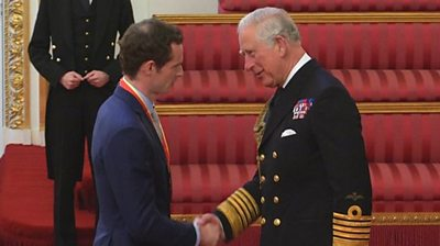 The tennis star attends a ceremony at Buckingham Palace for the award given in the 2016 New Year Honours list.
