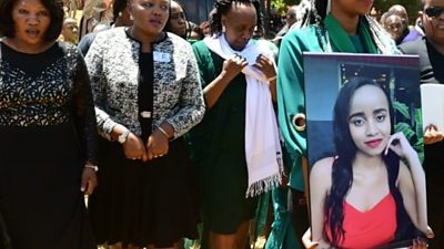 Large photo of Ivy Wangechi held up at her funeral