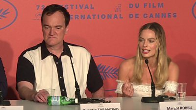 Margot Robbie speaking at Cannes press conference