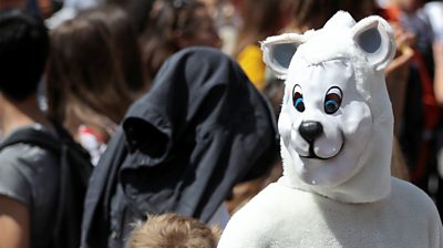A protester dressed in a polar bear costume is seen in Brussels