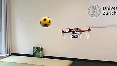 The drone avoids a football
