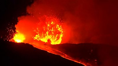 Mount Etna lights up night sky