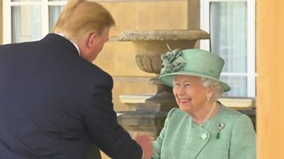 President Trump shakes the Queen's hand