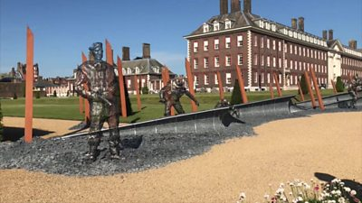 Sculptures of WWII soldiers, made of thousands of individually welded washers.