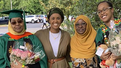 Falhad Ahmed Mohamud (L) and her daughters Sofia (L centre) and Amina (R)