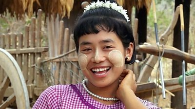 Burmese woman has tucks her hair behind her ears to show she is ready to date.