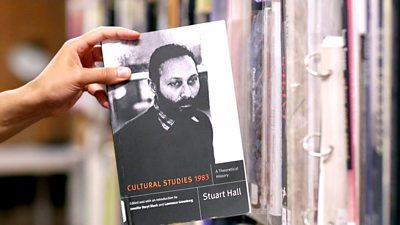 Hand holding a copy of 'Cultural Studies' by Stuart Hall