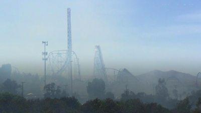 Amusement park clouded by smoke
