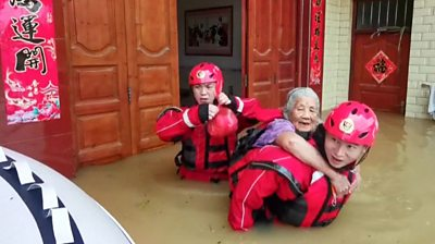 Old woman being rescued
