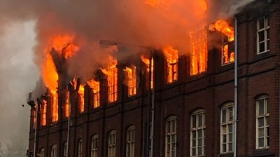 Warehouse engulfed by flames
