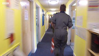 RAF personnel running in corridor