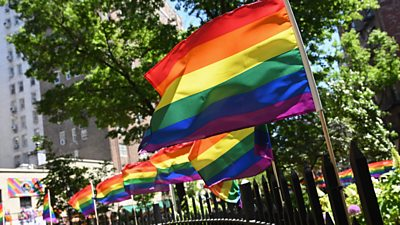 Rainbow flags outside Stonewall National Monument