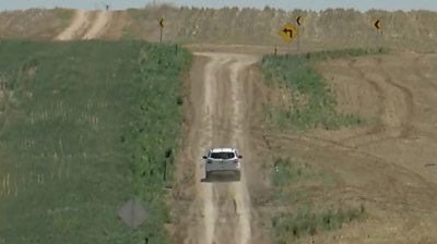 Car on unpaved road