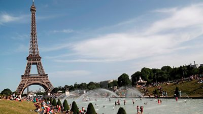 People bathe in the Trocadero Fountain near the Eiffel Tower in Paris during a heatwave on June 28, 2019.