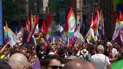 Crowds of people march at New York Pride