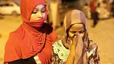 Girl weeps outside the detention centre after the attack