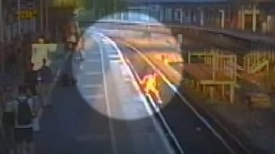 CCTV of Tegan getting on to the rail track