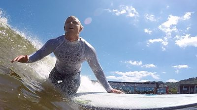 Adaptive surfer Llywelyn Williams in action at Adventure Parc Snowdonia
