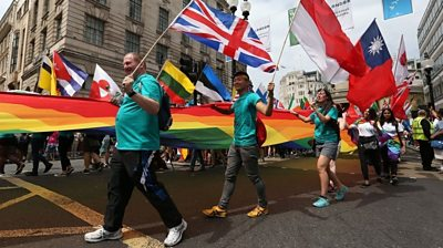 People take part in the Pride in London Parade in central London