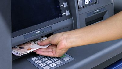ATM dispensing cash