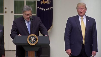 Attorney General William Barr, standing alongside President Trump