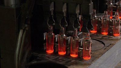 Robots marking bottles