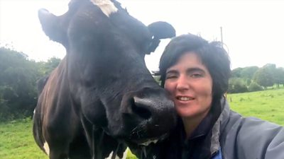 Abi Reader with one of her cows
