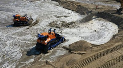 Huge sand dune designed to prevent major gas terminal falling into sea